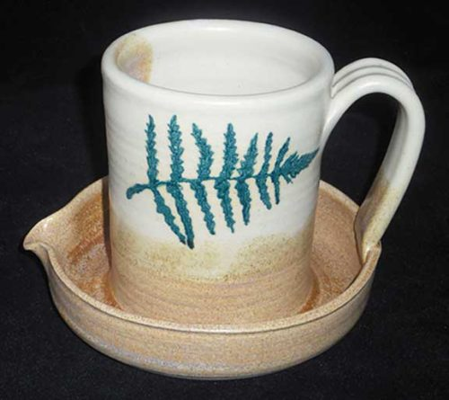 New Morning Gallery Fern Leaf Stegall Pottery Ceramic Bacon Cookers are made with food-safe ceramics glazes.