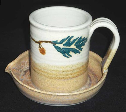 New Morning Gallery Oak Leaf Stegall Pottery Ceramic Bacon Cookers are made with food-safe ceramics glazes.
