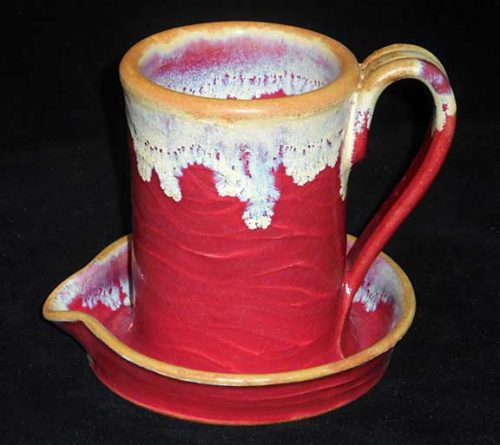 New Morning Gallery red Allan Ditton Ceramic Bacon Cookers made with food-safe ceramics and glazes.