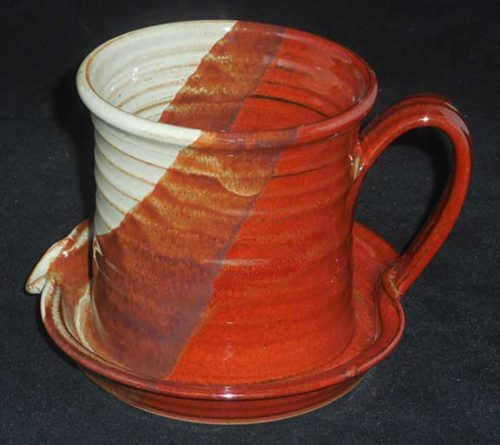 New Morning Gallery Rust White Patrick Rowe Ceramic Bacon Cookers are made with food-safe ceramics glazes.